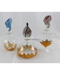 bottiglie vetro soffiato assortite con astuccio.