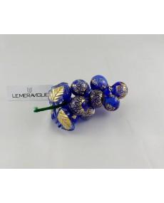 grappolo d'uva in vetro blu e oro